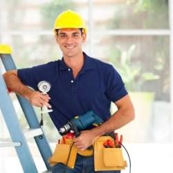 Worker with toolbelt, hard hat, step ladder - installer