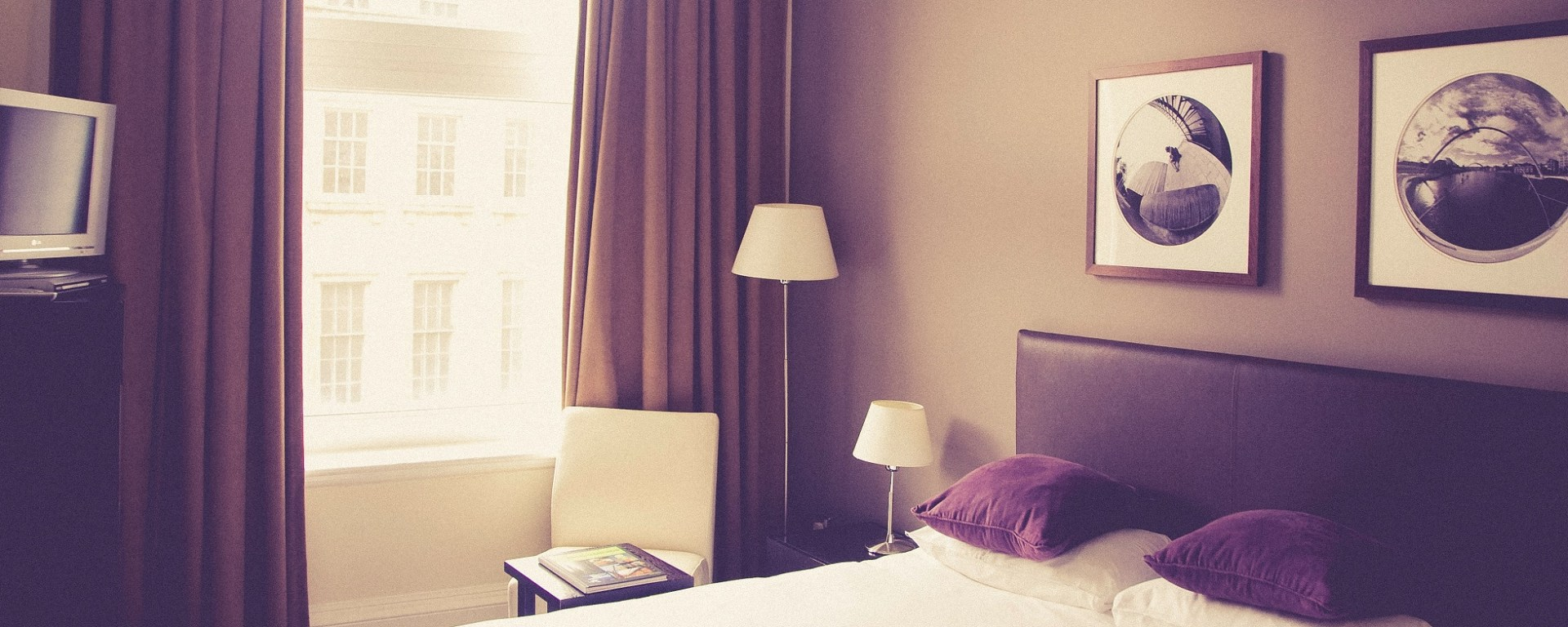 hotel room with drapes