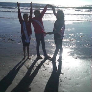 Preteens at the beach spelling out NAM 10