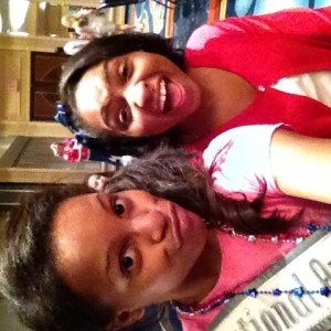 Deja and Azia letting off steam at the Patriotic rehearsal by making silly faces