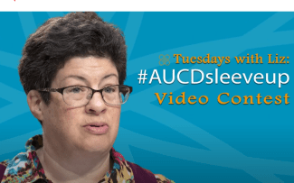 image: photo of Liz Weintraub, a white woman with brown hair and glasses, in front of a blue background with the words 'Tuesdays with LIz: #AUCD Sleeve Up Video Contest