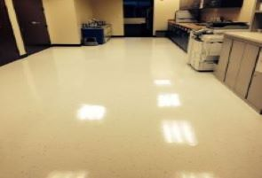 Office with shiny VCT tile just waxed.