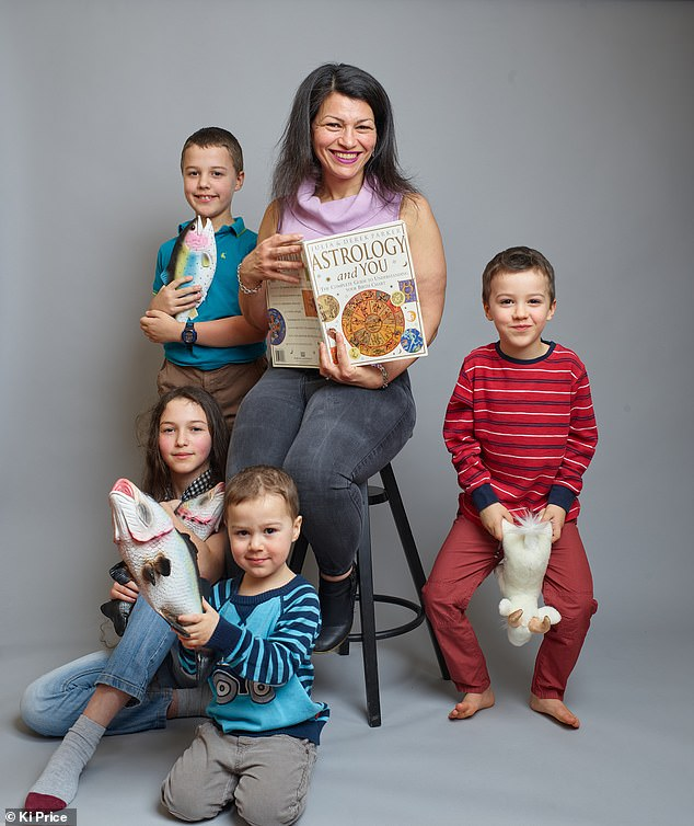 Inbaal Honigman, 46, from West Yorkshire, (pictured with her four children, aged three to 14) sees astrology as a way to understand her children's personalities and be a good parent