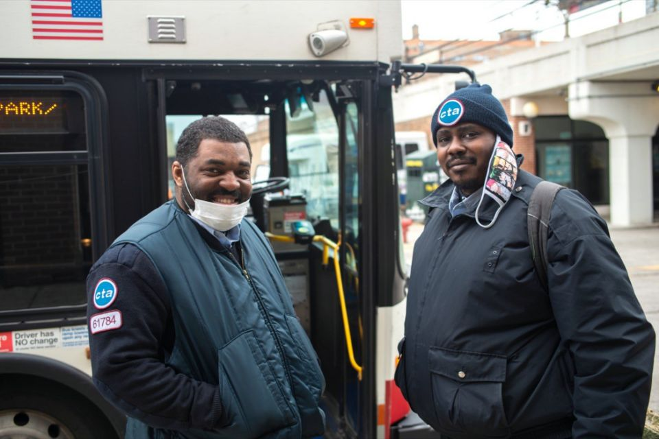 CTA Bus Drivers in masks taking a break near Foster and Broadway