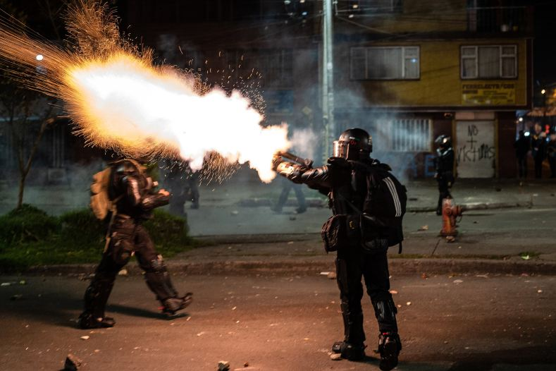 BOGOTA, COLOMBIA - 2021/09/09: A police officer seen firing tear gas into a crowd of protesters during the demonstration. The strike is in response to the anniversary of when police killed 13 people during one night in Bogota, Colombia one year ago. The protest is part of an on-going national strike that began in Colombia on April 28th in reaction to tax reforms that would target the poorest in the country. (Photo by David Lombeida/SOPA Images/LightRocket via Getty Images)