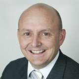 Picture of Dr Richard Denniss smiling.