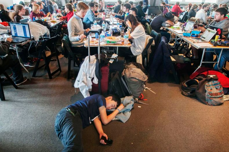 Andrew Tian, a student at the Texas Academy of Mathematics and Science at the University of North Texas in Denton, grabbed a power nap as hundreds of his fellow hackers worked on apps, websites and other tech projects at HackDFW.