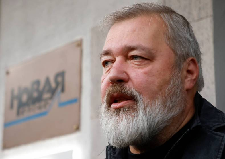 Russian investigative newspaper Novaya Gazeta's Editor-in-Chief Dmitry Muratov, one of 2021 Nobel Peace Prize winners, speaks with journalists in Moscow on Friday. | REUTERS
