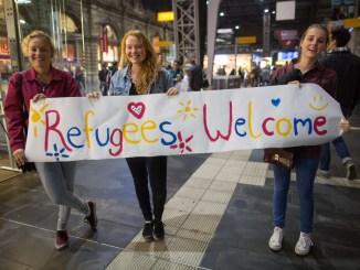 german girls welcome refugees