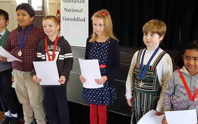 6 children with certificates and awards