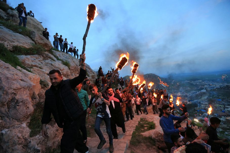 Iraqi Kurdish people carry fire torches up a mountain, as they celebrate Newroz Day, a festival marking their spring and new year, in the town of Akra, Iraq March 20, 2018. REUTERS/Ari Jalal