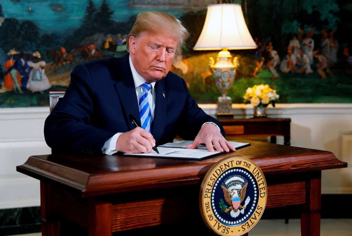 U.S. President Donald Trump signs a proclamation announcing his intention to withdraw from the JCPOA Iran nuclear agreement at the White House in Washington