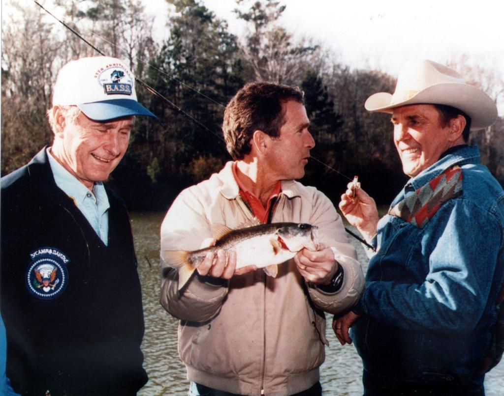 Presidents George H.W. Bush and George W. Bush with outdoor icon Ray Scott.