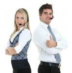 Young employee working with a headset and accompanied by his