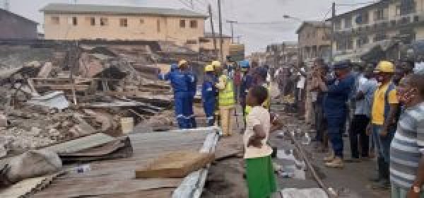 LASEMA demolishes buildings razed by fire in Lagos
