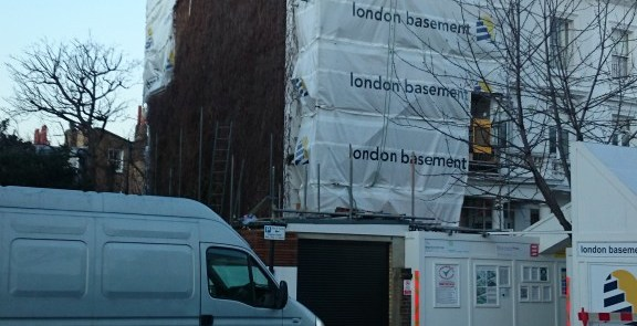 london basement company fines for adverts