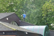 Man risks falling from roof