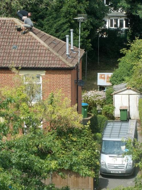 roofers replacing ridge