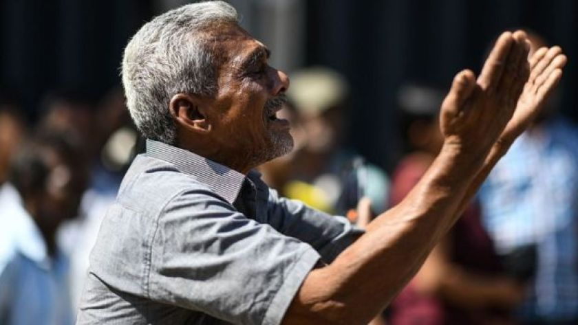 A man cries as he prays outside the St Anthony's Shrine in Colombo on April 22, 2019