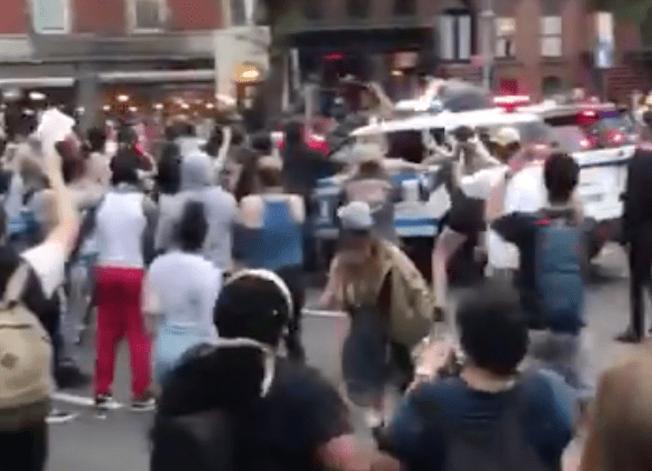 Police use SUVs to aggressively attack, plow through, crowd of protesters
