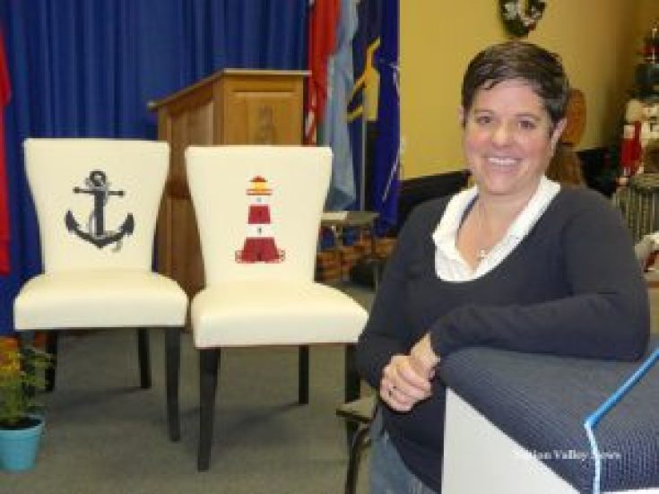 At the Chesterville Farmer's Market Christmas sale earlier this month, Lisa Boucher shows off a couple of repurposed chairs, rescued from the end of a driveway and recovered in vinyl through the handiwork of her husband, Corey, at Boucher's Upholstery. Zandbergen photo
