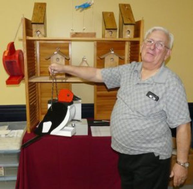 """Doug Johnson of """"Our Creations"""" displays one of his birdhouses at the Legion's Christmas Craft Show, Nov. 5. Zandbergen photo, Nation Valley News"""