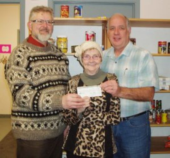 In another score for Community Food Share, the Morrisburg and District Arts and Crafts Association recently donated $512 to the organization formerly known as the Dundas County Food Bank. The donation represents proceeds from the admission fee for the group's 40th Annual Christmas Craft Sale, November 19-20 in Morrisburg. The Association's Dwight Aura and Linda Schenck are shown presenting the cheque to Community Food Share Administrator Ian McKelvie (right). Courtesy photo To date the Arts and Crafts Association has donated $2294 to the food bank. We appreciate their ongoing support of our work.