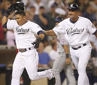 Cabrera celebrates his walk-off grand slam as he reaches home plate.