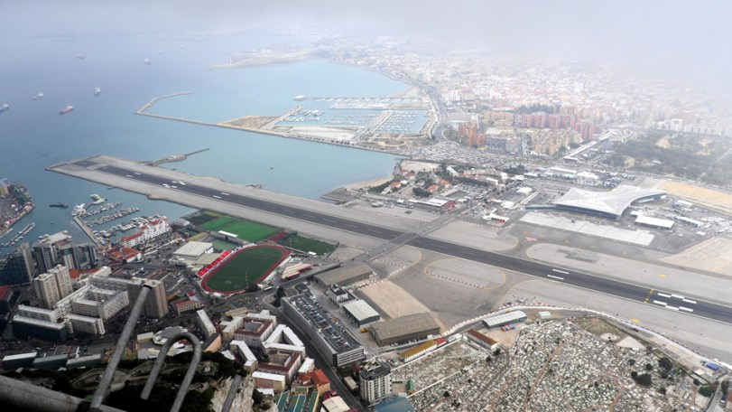 Panoramic view of Gibraltar Airport, handling a combination of civil and military aircraft.