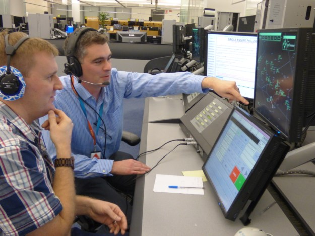 Pilot Tim Chambers (back) acting as an Aircraft Control Position Operator, playing the role as a pilot in the training