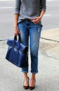 Slouchy boyfriend jeans paired with the right heels and sweater are strikingly flattering