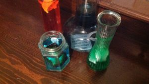 Potions in bottles with words and images representing stories.