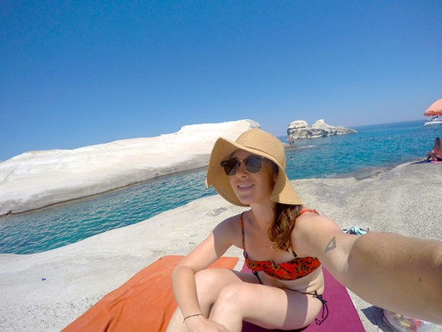 Enjoying those white rocks and blue water at Sarakiniko Beach // Nattie on the Road
