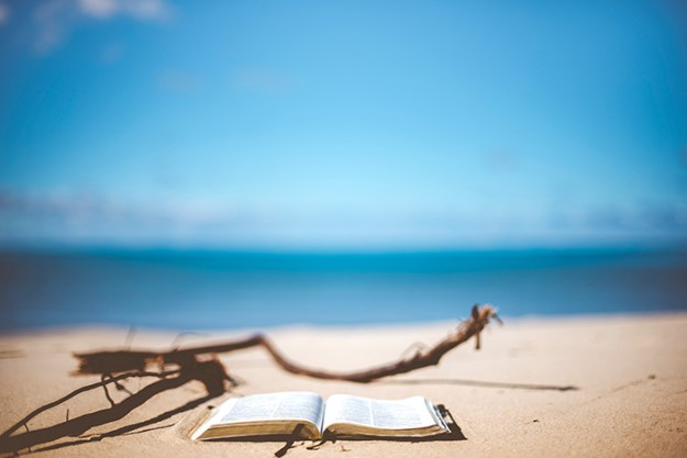 read on the beach in French Polynesia