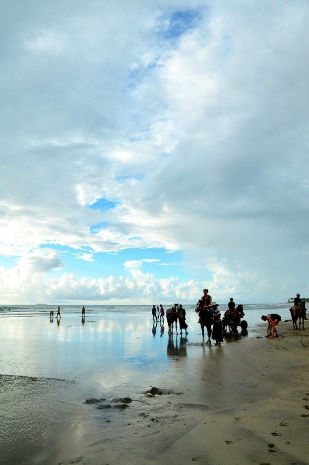 riding horses on the beach in Myanmar