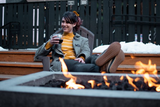 relaxing by the fire pit at The Coachman Hotel