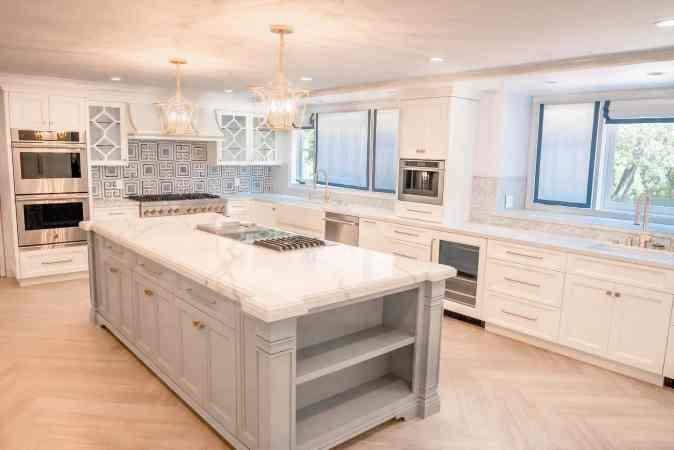island kitchen with marble countertop