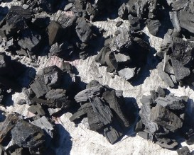small bundles of charcoal in the market