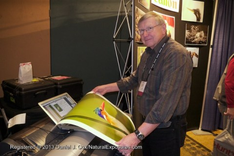 George Lepp checks a print from a Canon large format printer at the Canon booth.