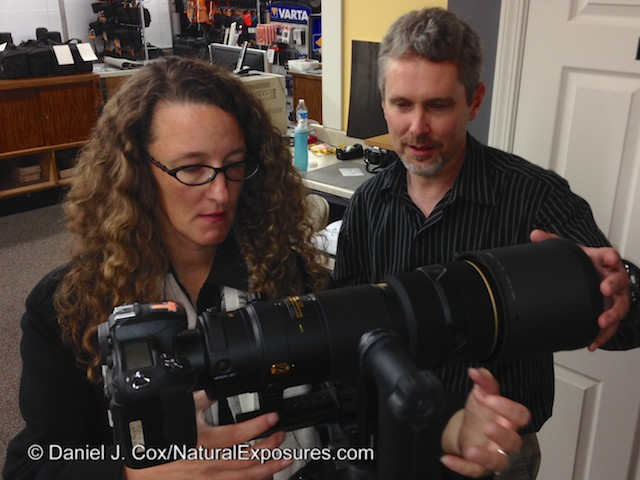 Marshal Lewis of Bozeman Camera and Rose Whitaker discuss the Nikkor 200-400mm lens at Bozeman Camera, Montana