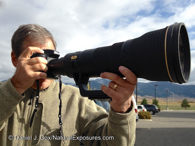 Daniel Cox gets a chance to try the new Nikkor 800mm F/5.6 that Nikon Rose Whitaker brought to the Bozeman Camera Photo Expo in Bozeman, Montana