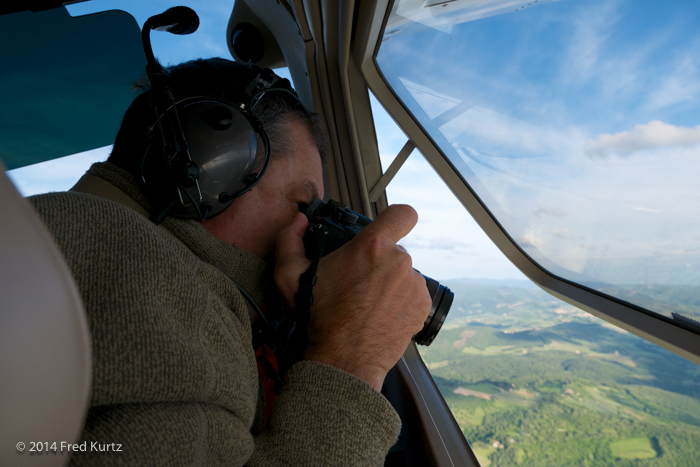 Dan shooting aerials from a Cesna 172, the Lumix GH4 with the 12-35mm F/2.8 lens over the Tuscany countryside. Italy