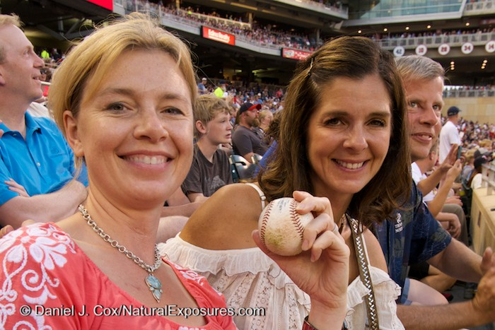 Tanya and Suzy are all smiles after a Chicago White Sox player through them a game ball. Lumix with 12-35mm. ISO 500