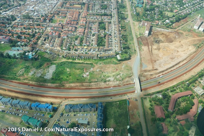 Flying over the suburbs of Nairobi you can see one of the newly paved highways. Lumix LX100, ISO 320