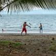 Bottle juggler on beach