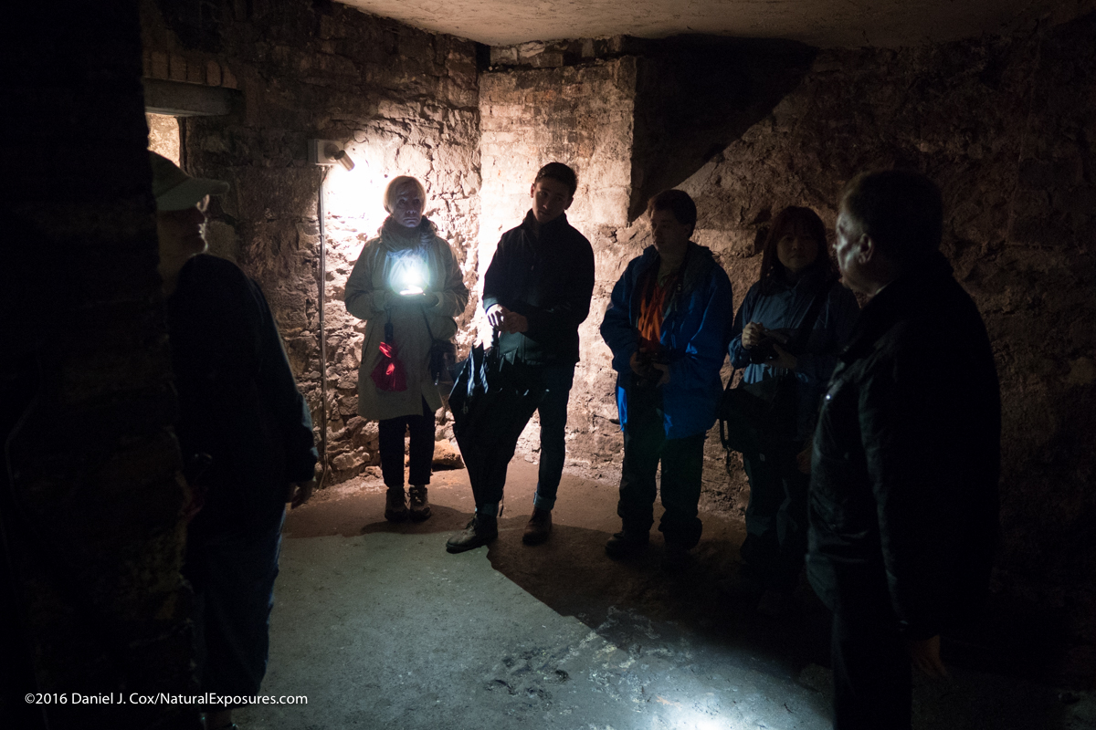 Our Explorers on a tour of the underground tunnels in Edinburgh. Typically a bright light like the flashlight in this photo would create flair in a lens that has issues. but as you see there is no problem in this situation. GX8 ISO 3200