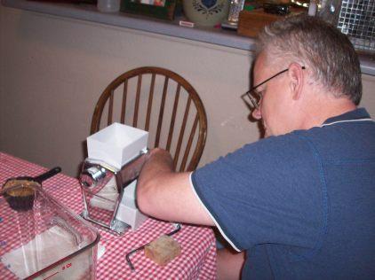 Paul grinds the grain