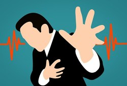 Foods that prevent stoke: Image of man holding his heart having a stroke