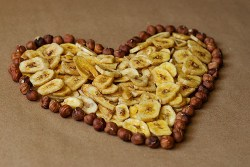 Heart-healthy diet: Image of bananas and nuts in the shape of a heart