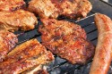 steak and sausages on the grill